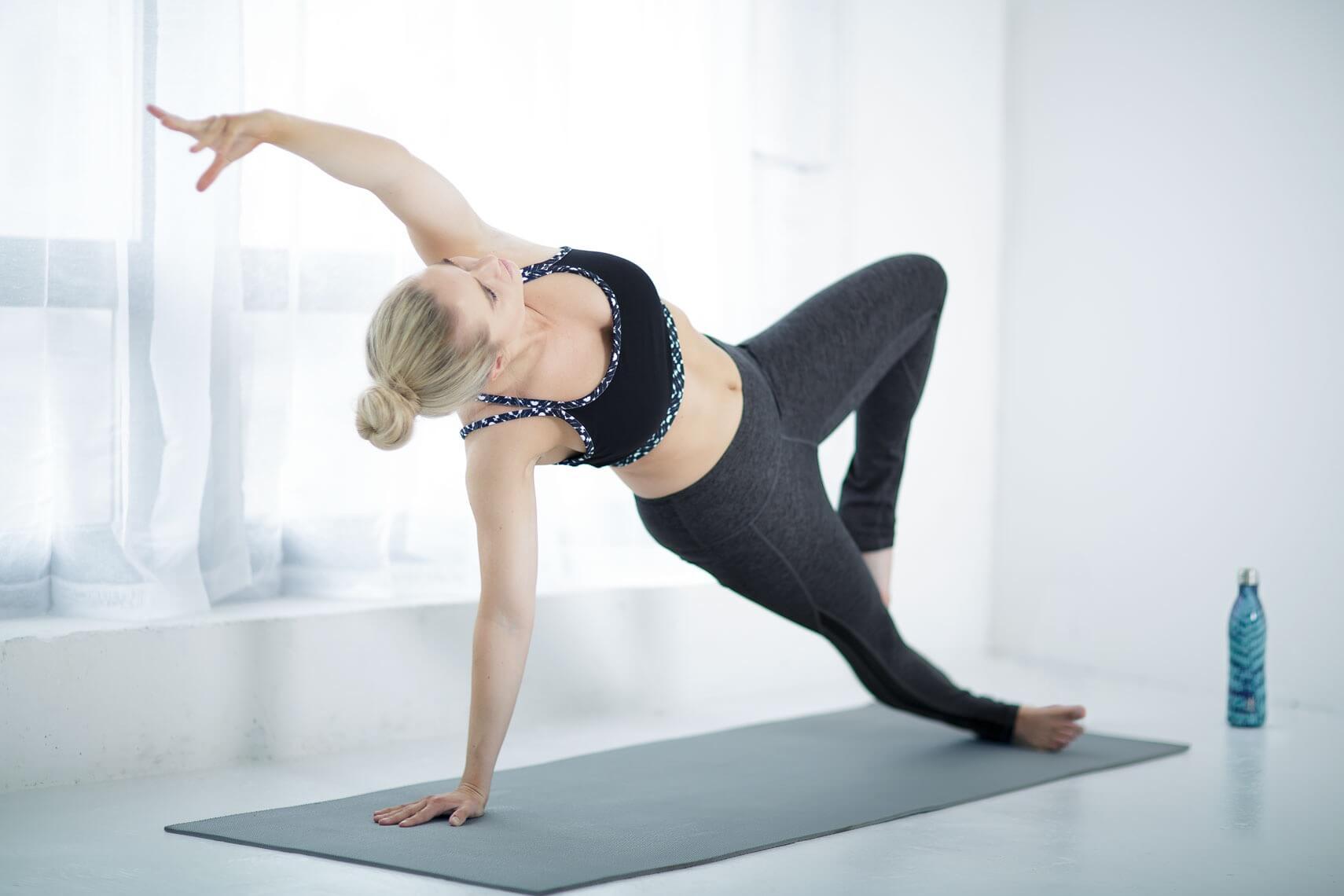 woman doing side plank Vasisthasana
