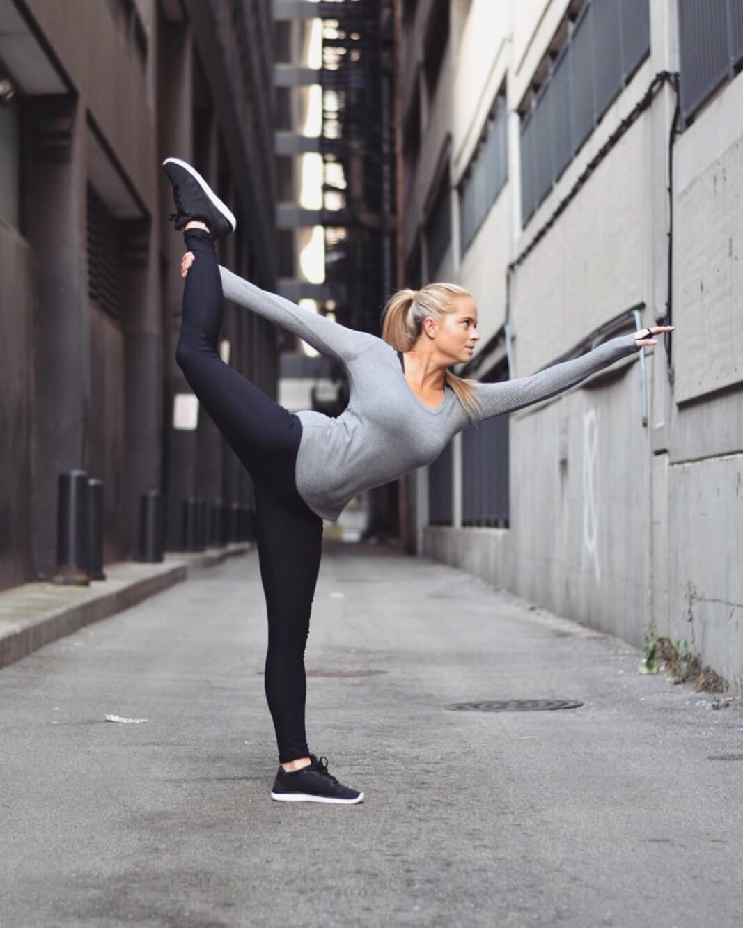 woman doing yoga dancer's pose Natarajasana