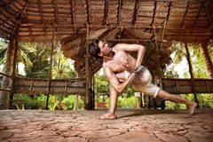 How does twisting in yoga help with detoxification?