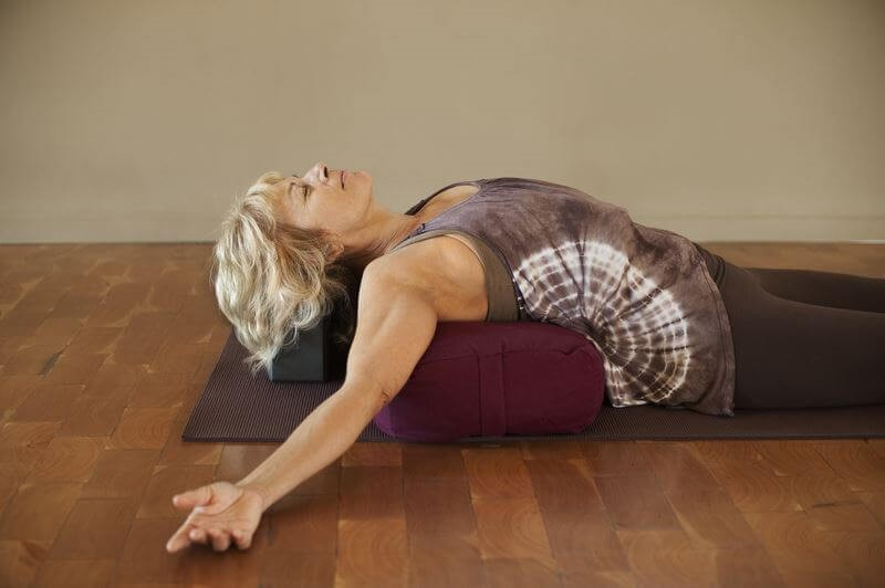 Turn That Yawn Into Yin and Relax Into This Style of Yoga