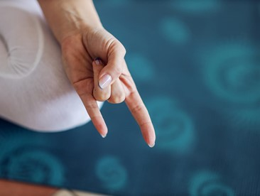 Close up of yogi woman holding hand in Apana Mudra