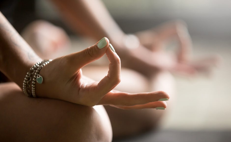 Gyan mudra close up, woman joining together the tip of index finger with thumb