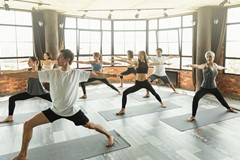 Millennials practicing yoga in a modern studio stock photo