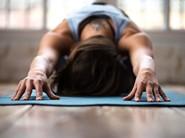 Woman doing yoga childs pose