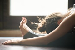 Young woman in paschimottanasana pose